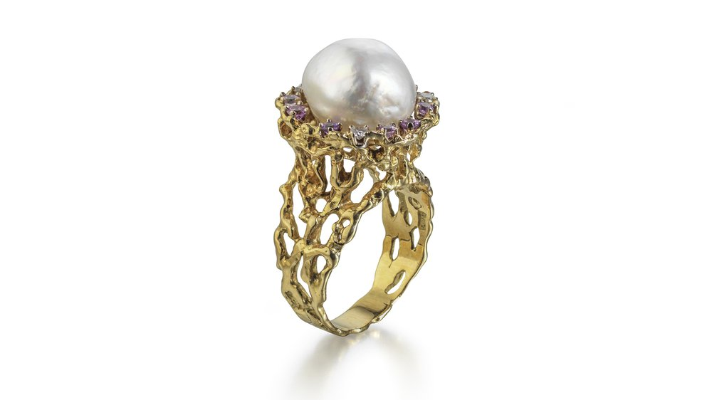 18ct yellow gold open nugget flake ring set baroque South Sea pearl, surrounded by pink and blue sapphires. 1992