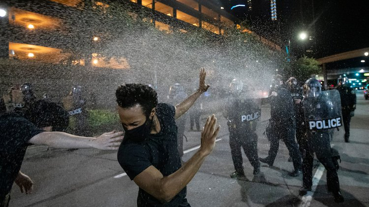 Protesters sprayed with pepper spray by officers after a rally against police brutality. Detroit, 29 May, 2020. Photo: Junfu Han / Detroit Free Press.