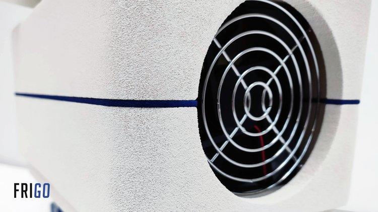 A fan on a white industrial unit