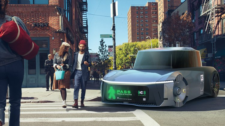 An autonomous vehicle stops to let pedestrians cross the street