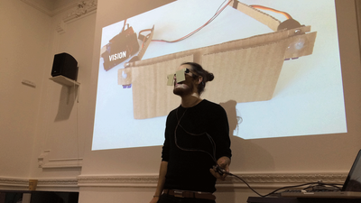 Oliver Smith presenting a prototype of a distraction display for the IED Exploded Screen elective