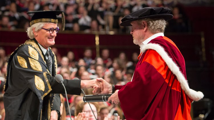 Sir Ridley Scott Receives his Honorary Doctorate from Provost Sir James Dyson at Convocation, 2015.