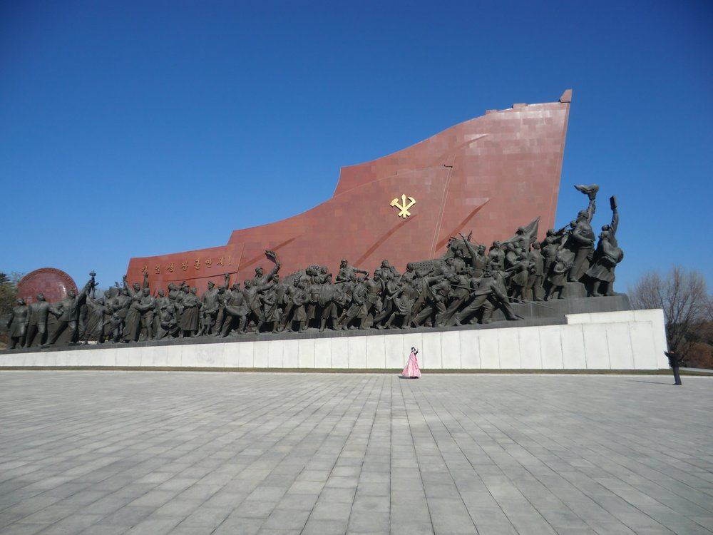 Couple making their wedding video in front of revolutionary monuments, Pyongyang, Democratic People's Republic of Korea