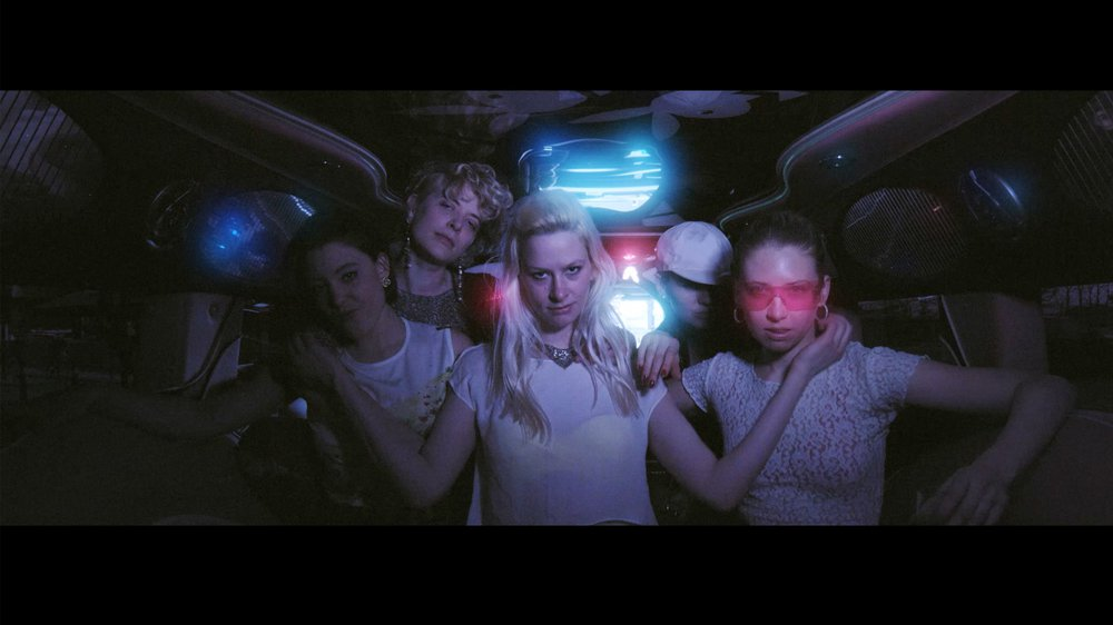 Kiss Me Click — The Visual Album (Video Still)