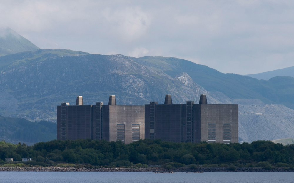 Designed by Basil Spence, Trawsfynydd Power Station was commissioned for the then-newly designated Snowdonia National Park in 1959. The site is expected to be returned to its 'pre–nuclear' state by 2083, 92 years after its closure.