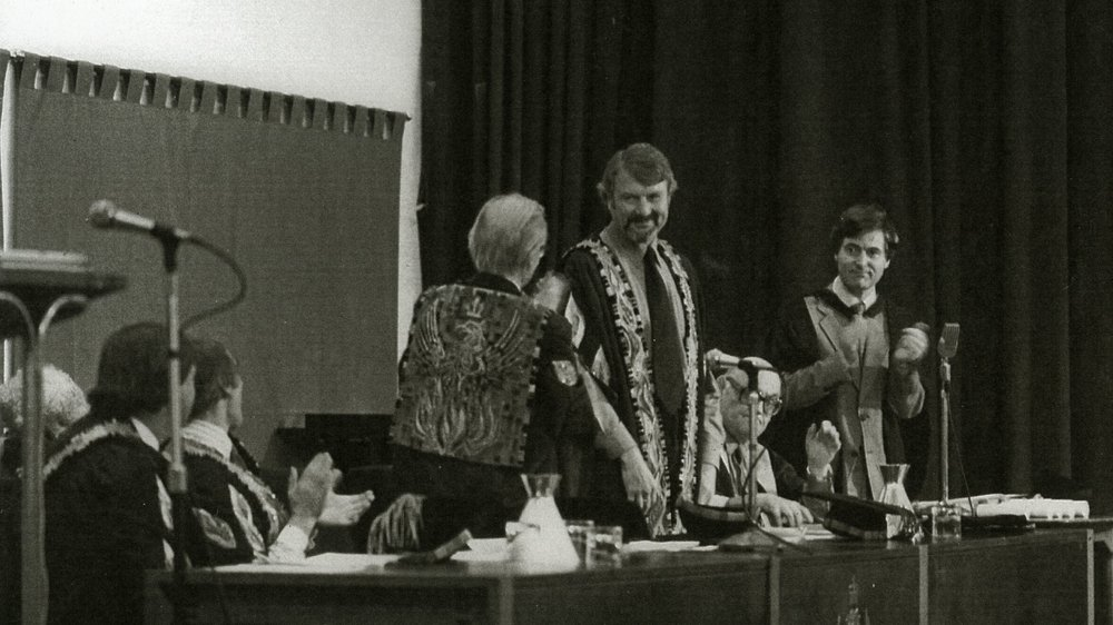 RCA Convocation, July 1982. John Hedgecoe (Pro Rector), Lionel March (Rector), Sir Hugh Casson (Provost), Peter Byrom (Pro Provost), Lord Howard (Treasurer), Brian Cooper (Registrar). Peter Byrom papers, Special Collections.