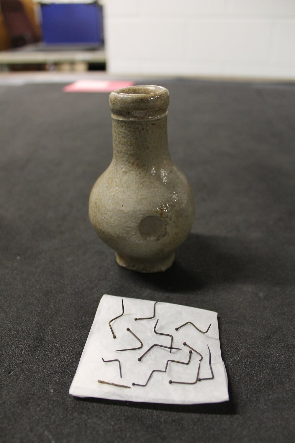 'Witch bottle' containing bent pins