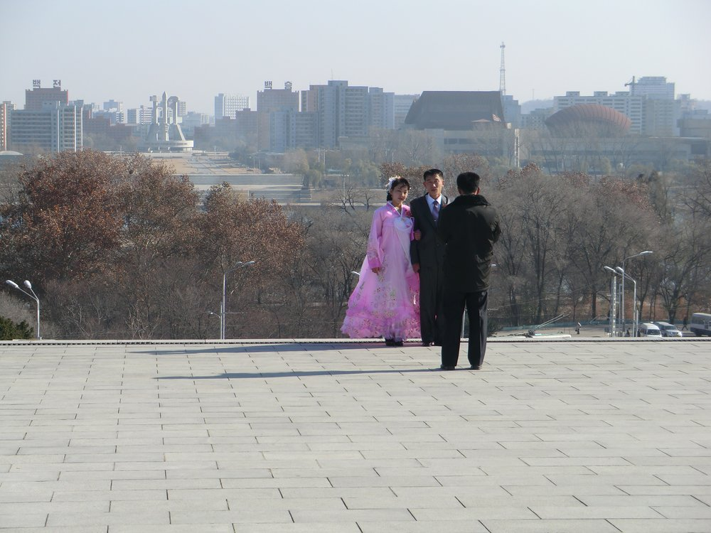 Couple having their photo taken on their wedding day, Pyongyang, Democratic People's Republic of Korea