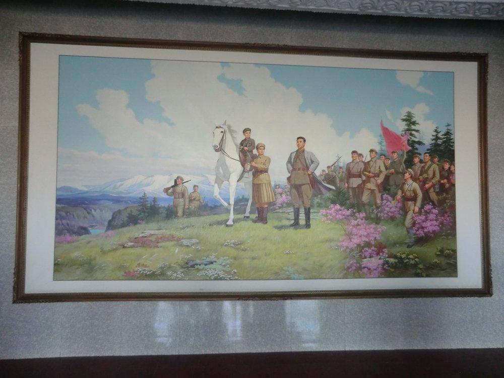 Painting of Kim Il Sung, Kim Jong Suk and Kim Jong Il in the entrance to Kim Jong Suk Middle School, Pyongsong, Democratic People's Republic of Korea