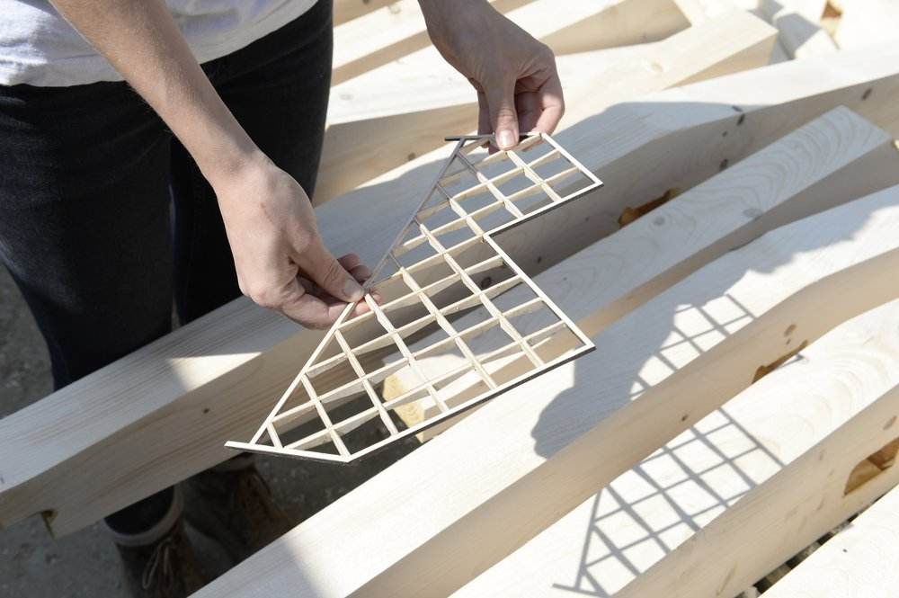 1:25 model of the back gable wall, held above 1:1 timber lattice pieces