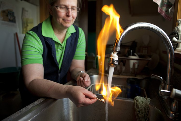 Water set on fire due to high concentration of methane linked to the destabilization of water wells as a result of fracking. Photo: Melanie Stetson Freeman, Getty Images