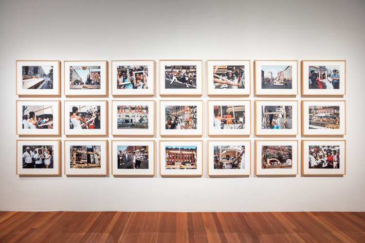 framed photographs on a gallery wall