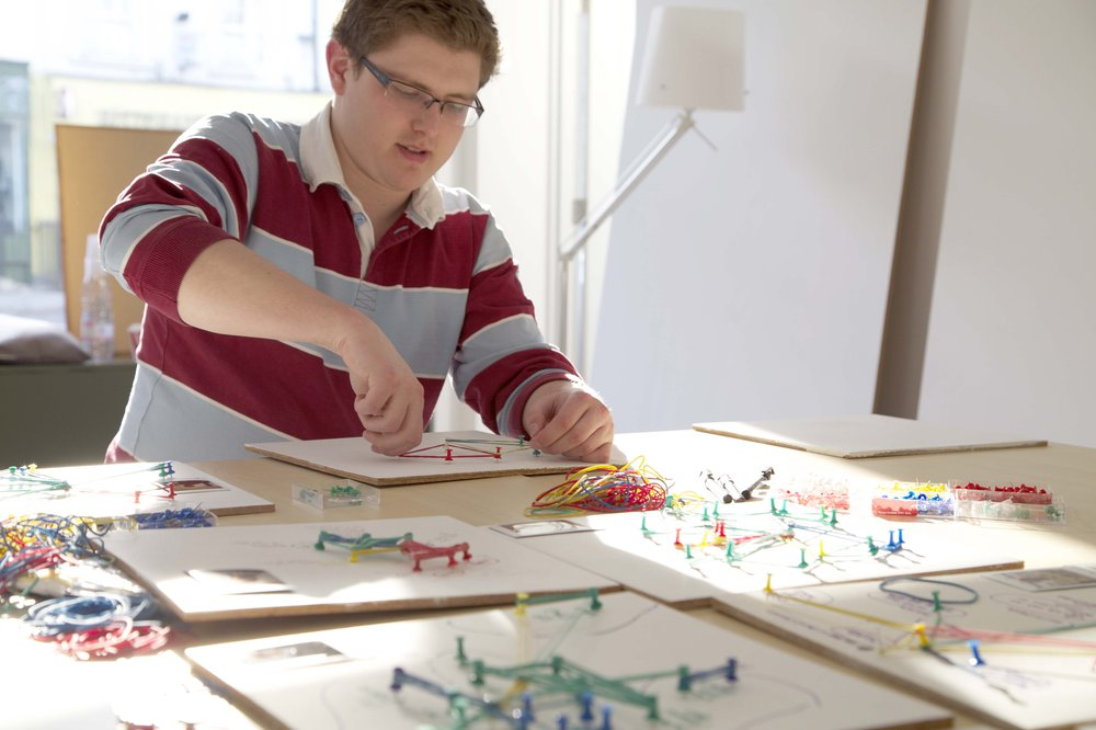 A research participant creates a physical model of his own digital social network