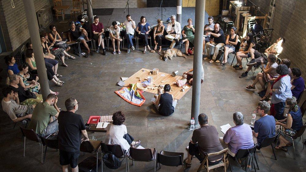 A meeting of the La Borda cooperative at Can Batlló, Barcelona