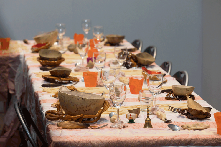 A dinner table laid with unusual bowels and place settings