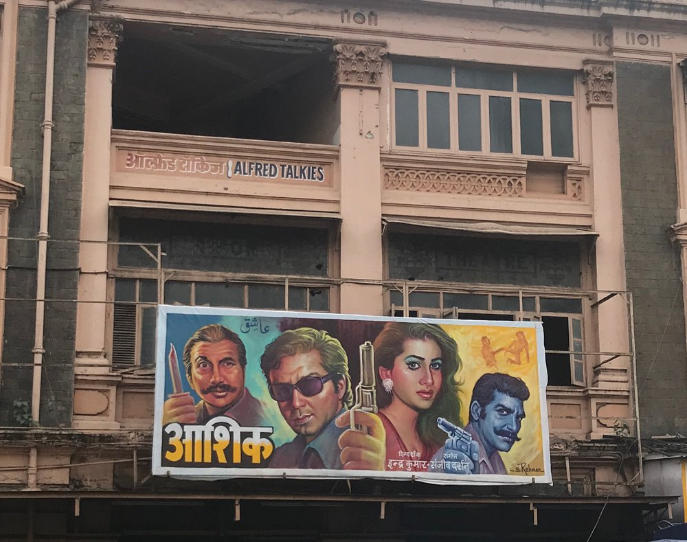 Hoarding for Aashiq (2001) displayed outside the Alfred Talkies Cinema, Mumbai