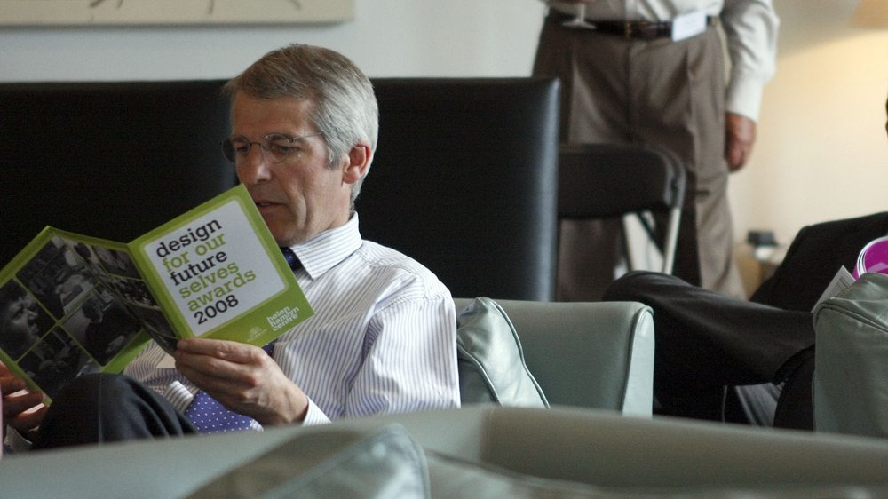 Audience member reading Awards leaflet