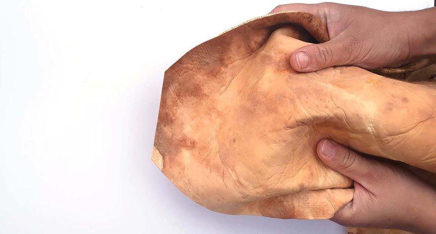 Mykkö - image of pair of hands holding Mykkö leather alternative