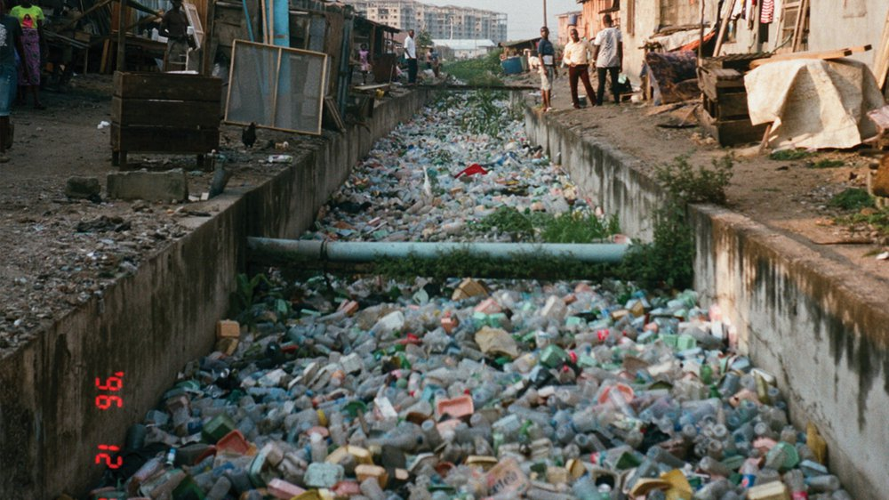 Blocked to bursting point: Canal in Lagos Island filled with plastic waste.