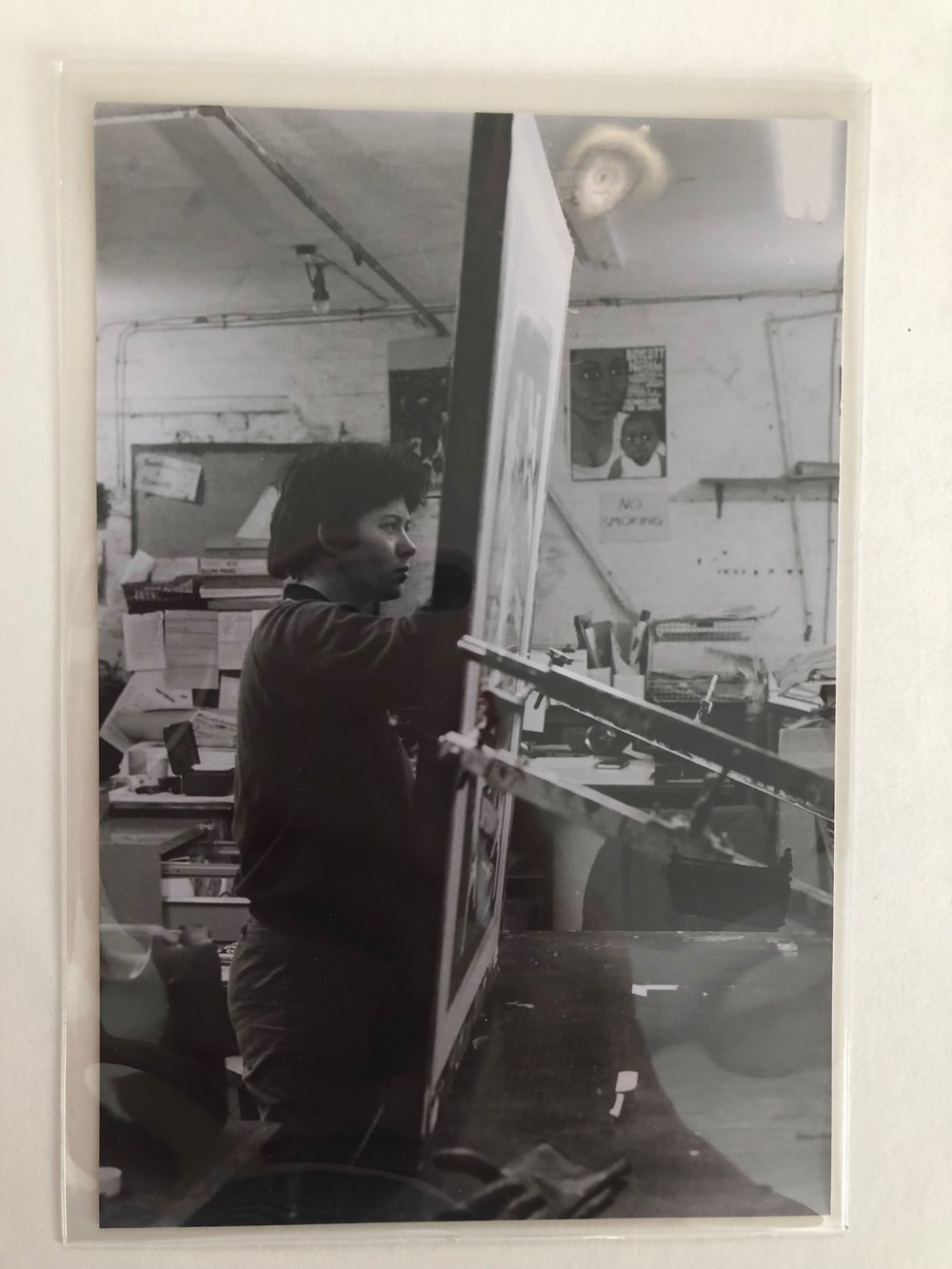 Jess Baines working on the 'Girls Are Powerful' poster at Iliffe Yard, 1976-83, See Red Women's Workshop Archive, LSE Women's Library. © See Red Women's Workshop.