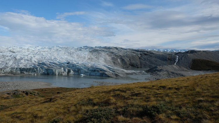 A photograph a Greenland, showing a glacier in the background
