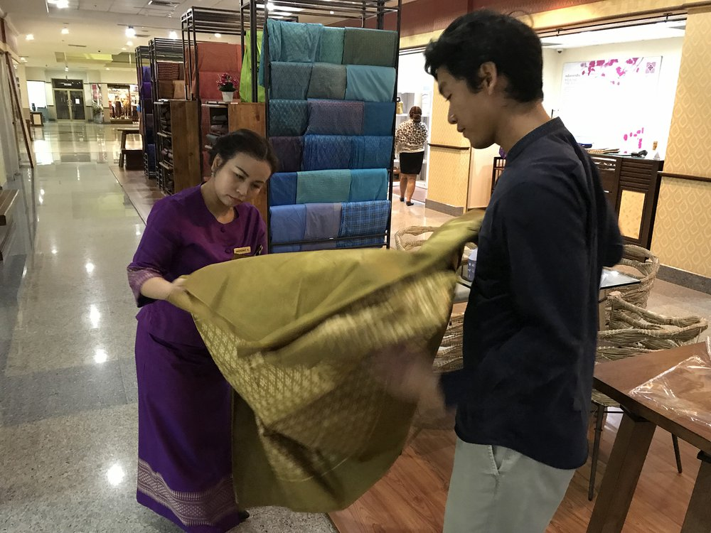 Dr Siriphon viewing Thai craft silk