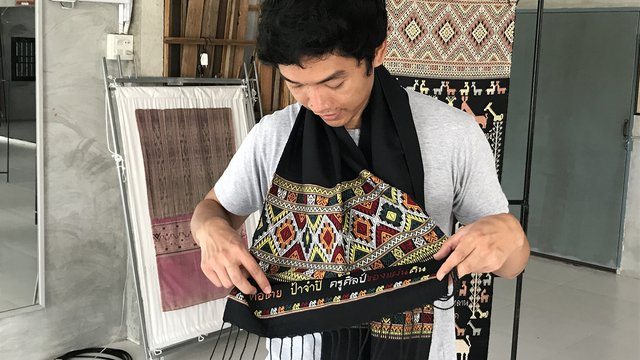 Dr Siriphon with Thai craft textiles