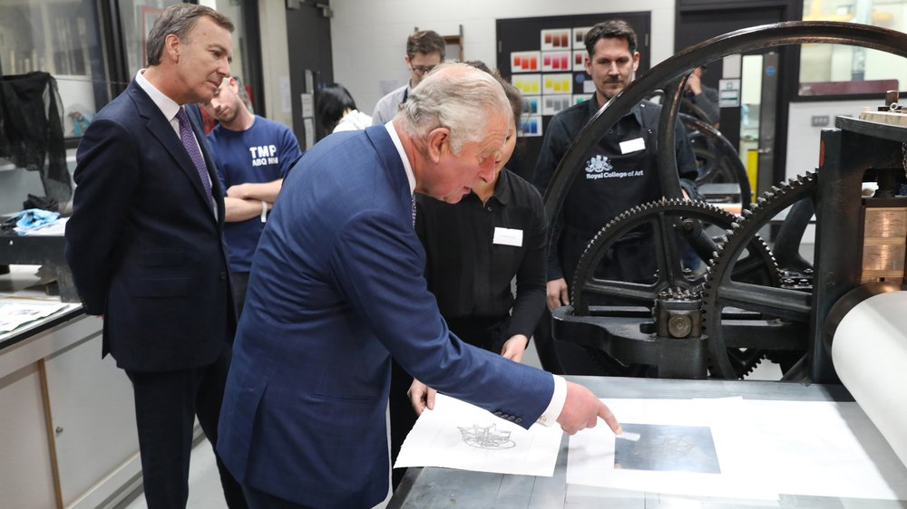 His Royal Highness The Prince of Wales creates a print with the 'Hockney Press'