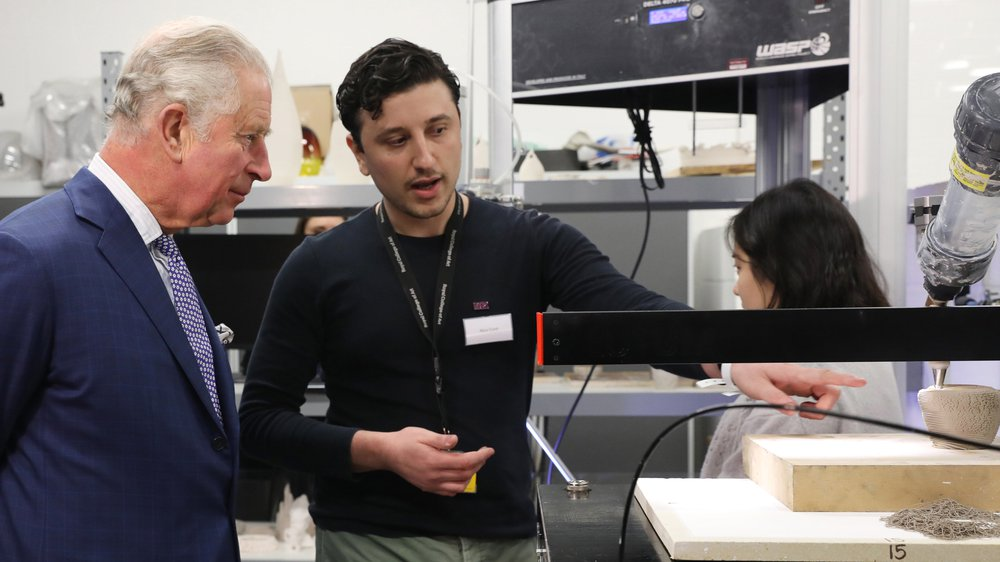 His Royal Highness The Prince of Wales with second-year Ceramics & Glass student Nico Conti and a digital ceramic printer