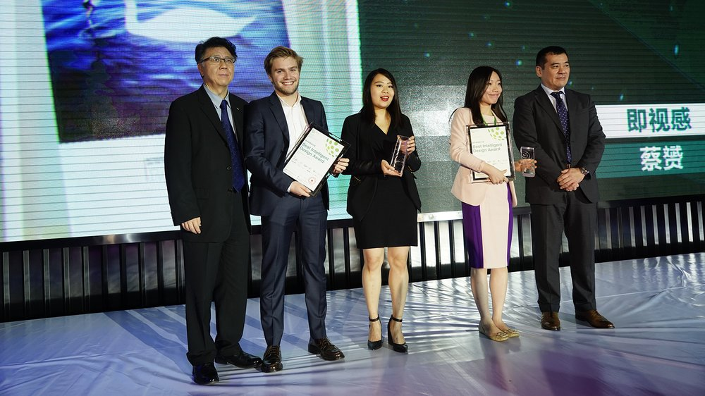 Alexander Kitching and Sheana Yu receiving first prize in the Best Intelligent Design category at the 2014 LotusPrize