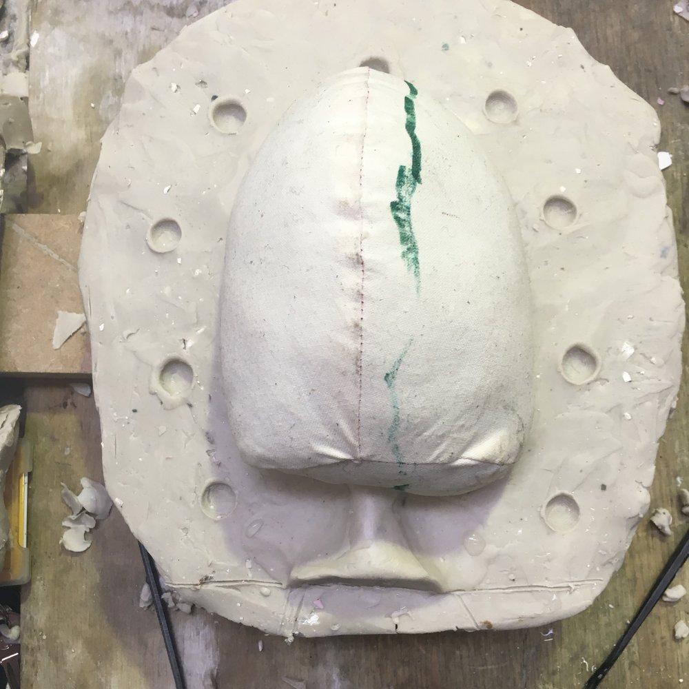 Stuffed head in mould