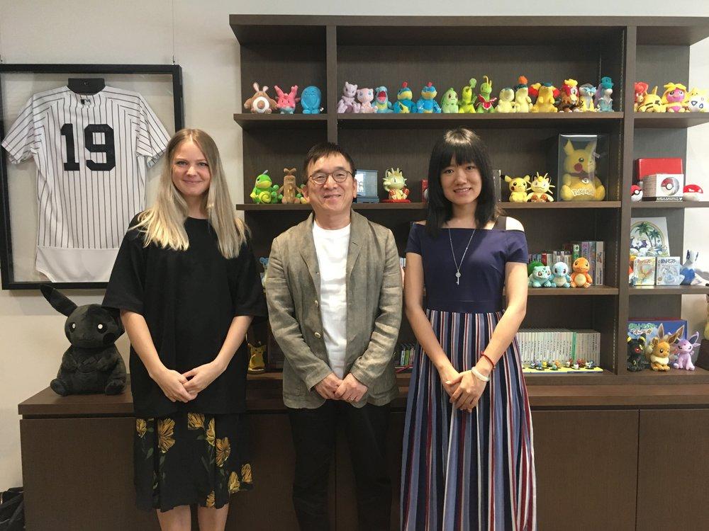 Pokémon Scholars, Ye Han and Marie Isacsson with founder of The Pokémon Company, Tsunekazu Ishihara.