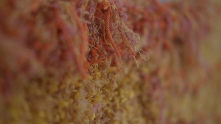 close up image of a textured wool and yarn surface