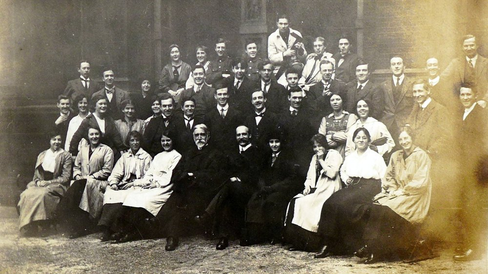 RCA students in 1914 in the Victoria and Albert Museum courtyard, with Professor Edouard Lanteri (front and centre, white beard), head of Modelling.