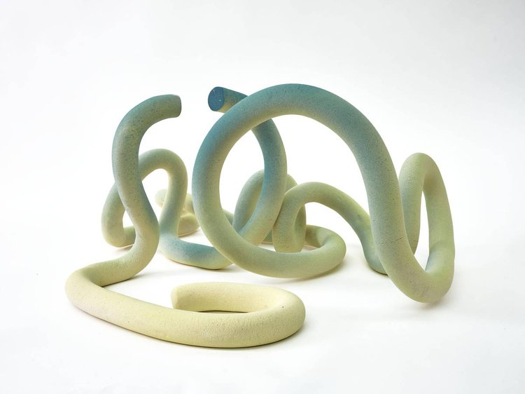 Gently pouring tangled spaghetti  Ceramic sculpture; stoneware and parian  By Liz Jackson (MA Ceramics & Glass, 2021)