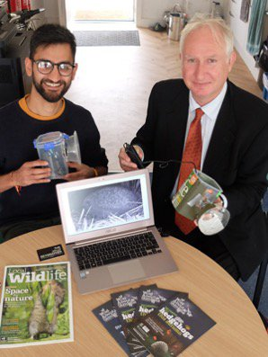 The Jolly Geographer (left) talking MP for Cambridge, Daniel Zeichner through the Ny Naturewatch hedgehog monitoring project with Wildlife Trust BCN