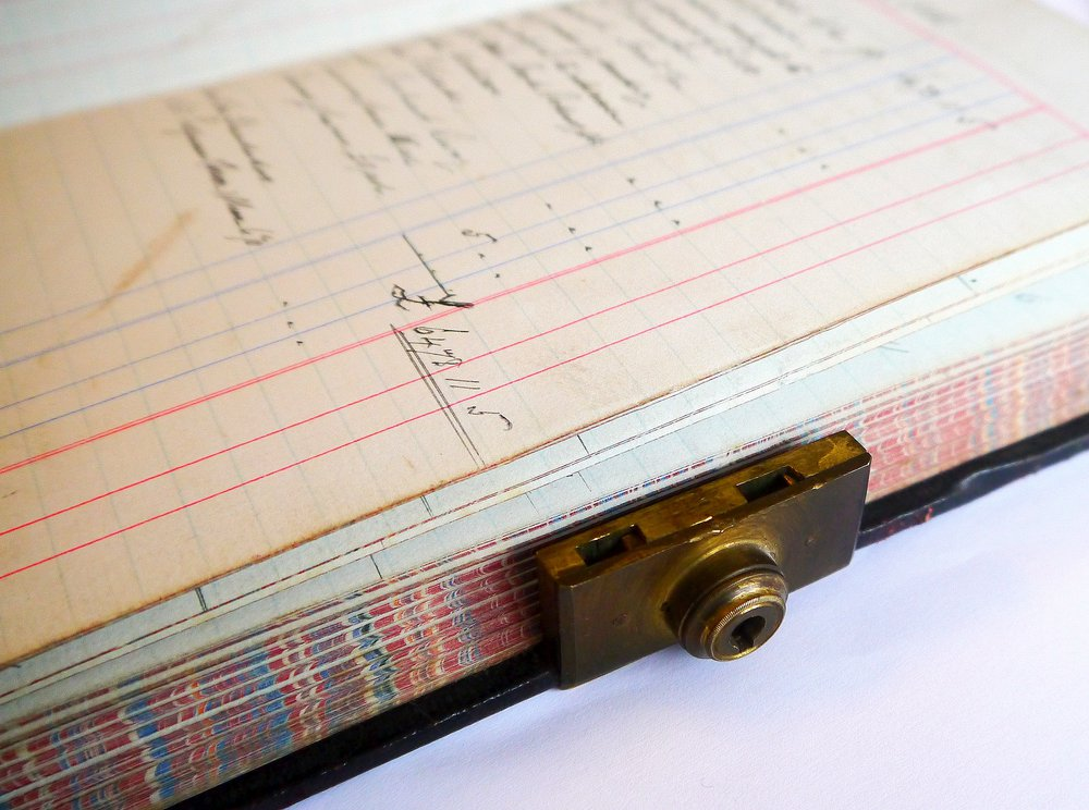 C. Early 20th century ledger with patented Bramah lock