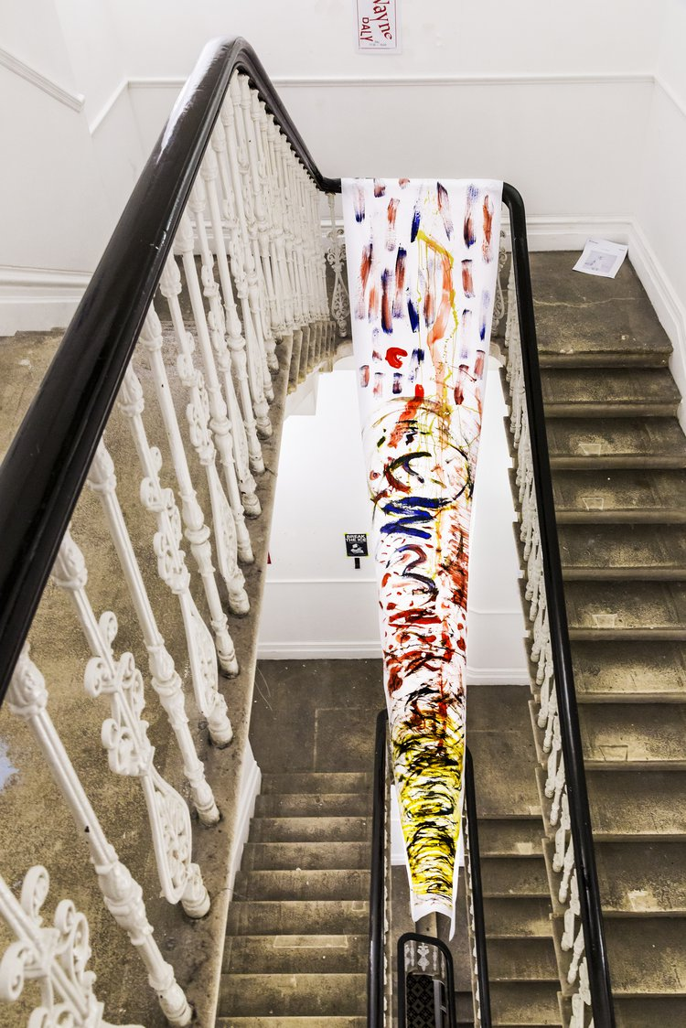 Student work hung over the staircase in an RCA building