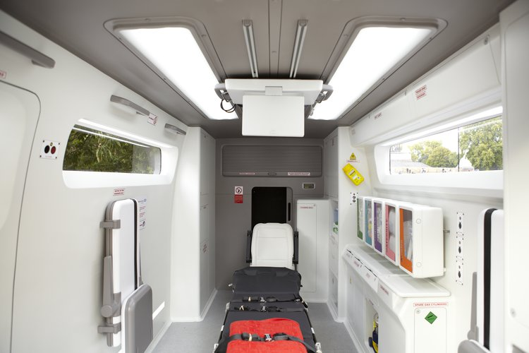 Image showing 2011 Redesign of emergency ambulance, with easy-clean surfaces, modular treatment packs, a central stretcher and a jump seat for a family member of friend to accompany the patient