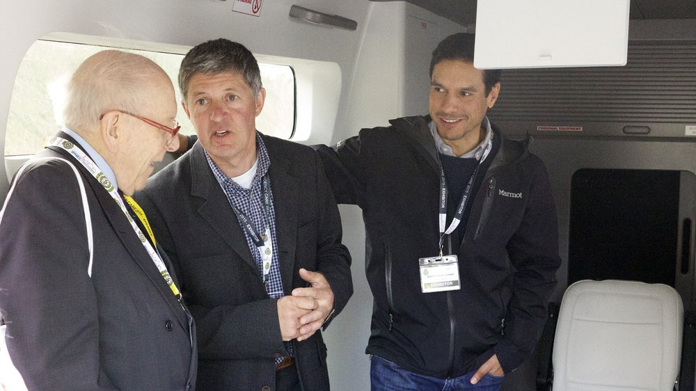 Prof Douglas Chamberlain on left with team members inside mobile demonstrator unit