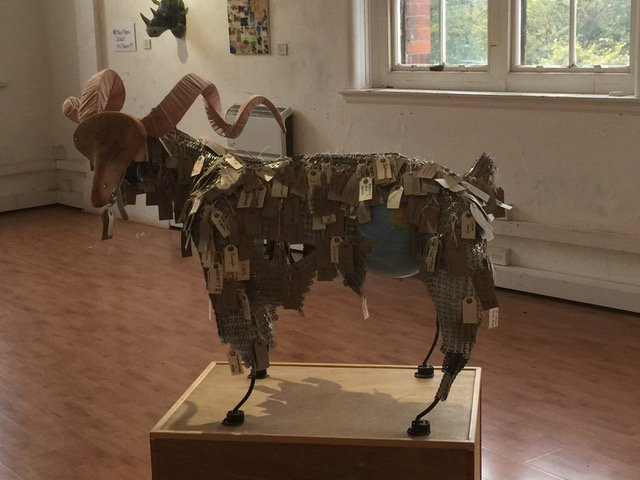 Scapegoat – An Interactive sculpture where members of the public are invited to hang 'tags of blame' on the goat to create a coat of burden.