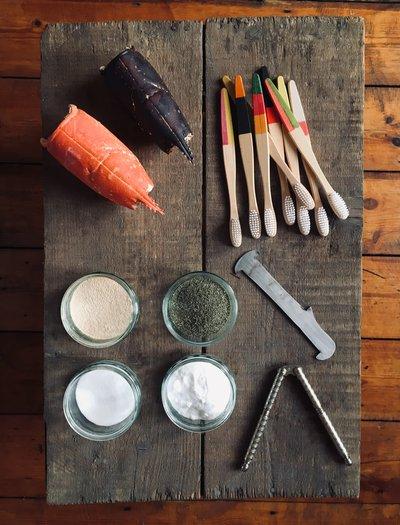 Tools on a wooden board alongside lobster shells