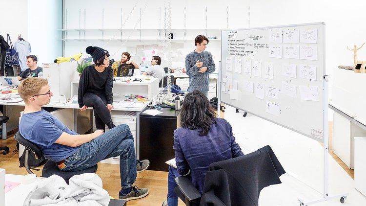 photograph of design students discussing ideas in School of Design studios