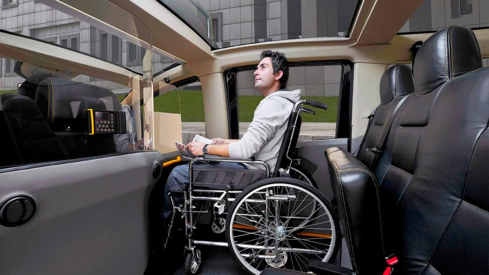 Interior showing forward-facing wheelchair passenger