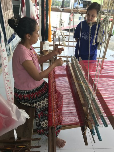Thai craft weaver at a loom