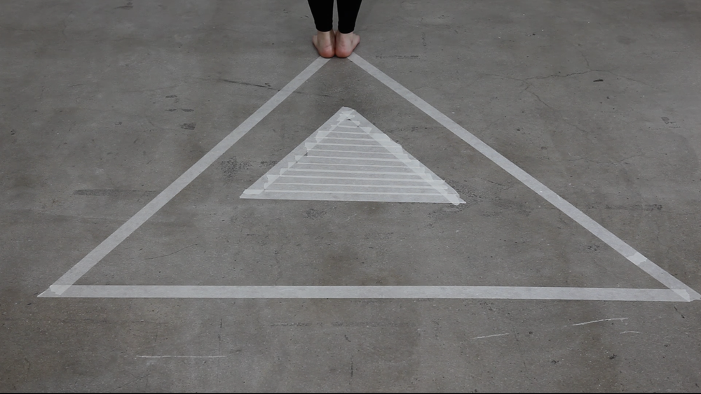 Still image from 'In-between two triangles'