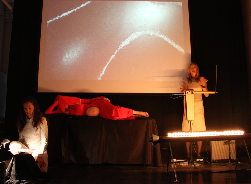 Still from film performance of 'Ventriloqua', restaged with thereminist Dorit Chrysler at Cabinet magazine events space, New York, 2012
