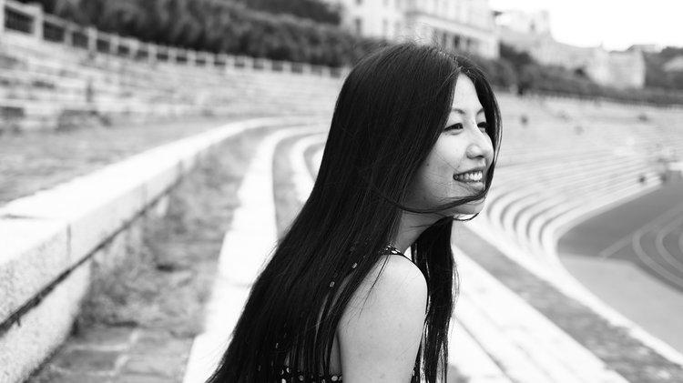 Black and white portrait of Yuzhen Cai