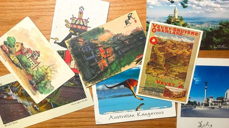 postcards spread across a table