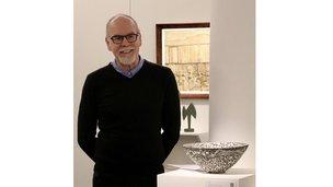 David Horbury with an Emmanuel Cooper stoneware bowl 2019 [Photo credit: Dan Vo]